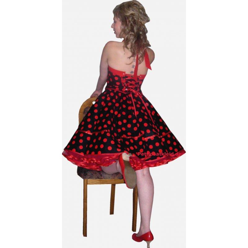 Schwarzes kleid mit roten punkten